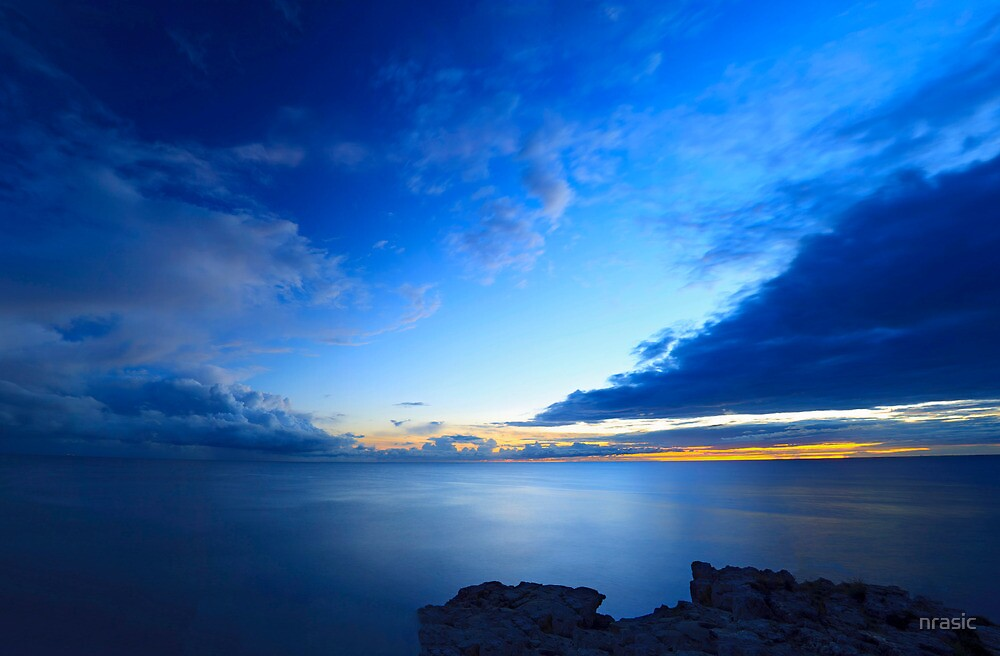 Beatiful blue sky over the sea and sunset by nrasic