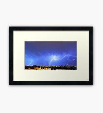 Lightning over the city Framed Print