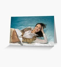 A young trendy dressed woman floats underwater Greeting Card