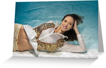 A young trendy dressed woman floats underwater by PhotoStock-Isra
