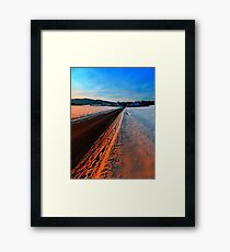 Winter road at sundown Framed Print