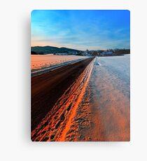 Winter road at sundown Metal Print