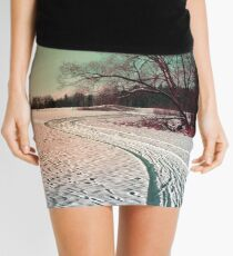 A snowy trail and some trees Mini Skirt