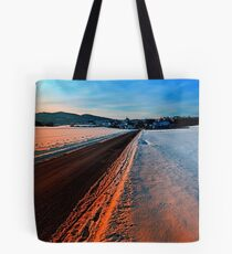 Winter road at sundown Tote Bag