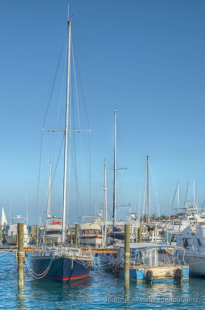 Boat docked at the marina behind Pop's Deck in Nassau, The Bahamas by Jeremy Lavender Photography