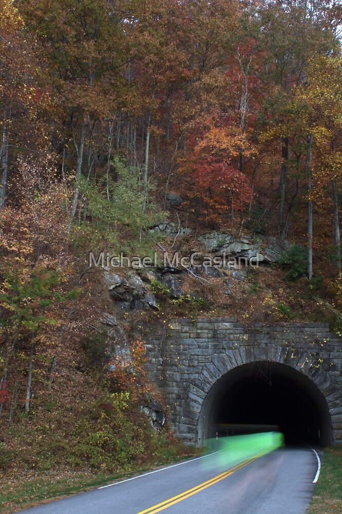 bicycling through tunnel 4 by Michael McCasland