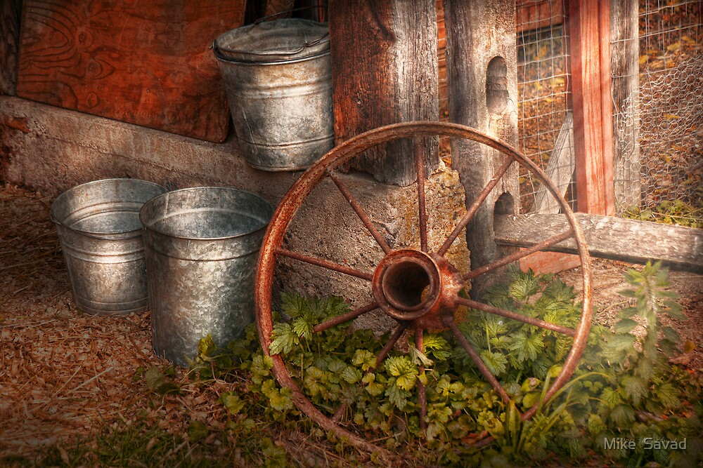 Country - Some dented pails and an old wheel  by Michael Savad