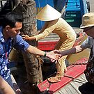 the crew-woman ties up the boat, as Ky helps us ashore. by geof