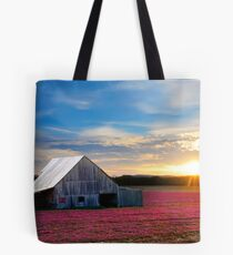 Spring growth of flowers and Barn at sundown Tote Bag
