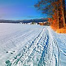 Hiking through a sunny winter scenery by Patrick Jobst