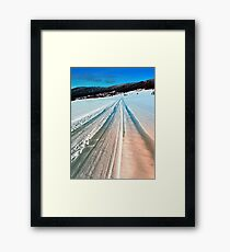 Winter road into the mountains Framed Print