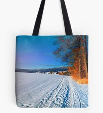 Hiking through a sunny winter scenery Tote Bag