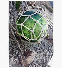 Traditional green glass fishing float and net, Brittany, France Poster