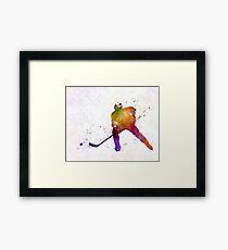 Hockey skater in watercolor Framed Print