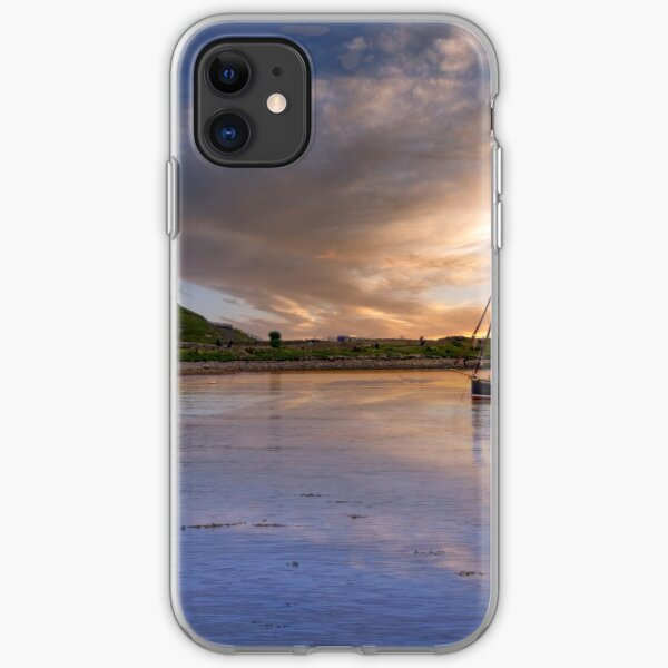 fishing boat in holy island harbour with lindisfarne castle iPhone Soft Case