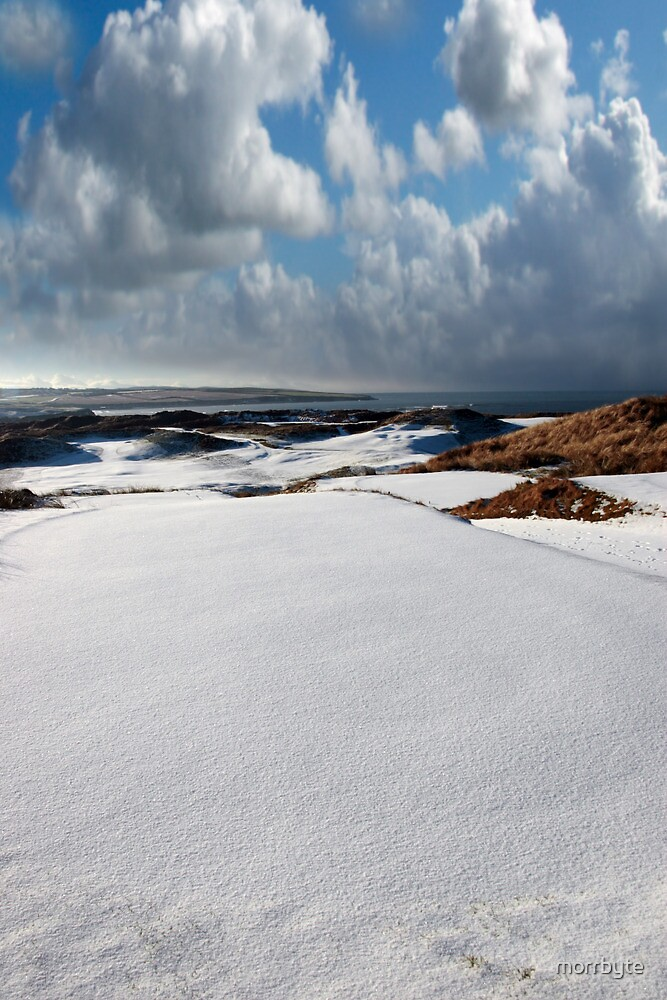 atlantic coastal snow covered links golf course by morrbyte