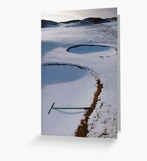 rakes in bunkers on a snow covered links golf course Greeting Card