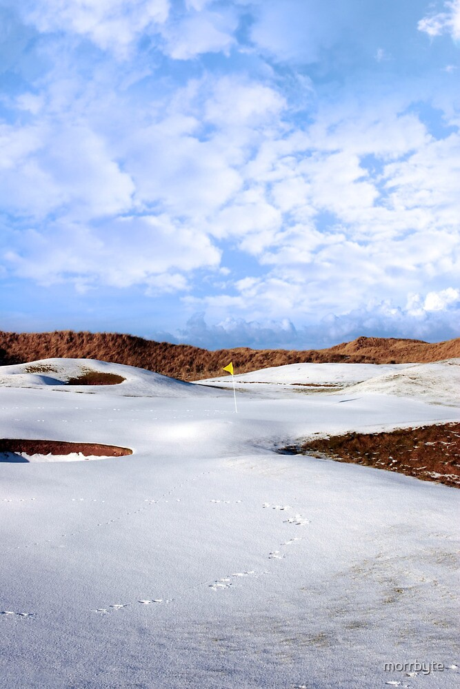 snow covered links golf course with yellow flag by morrbyte