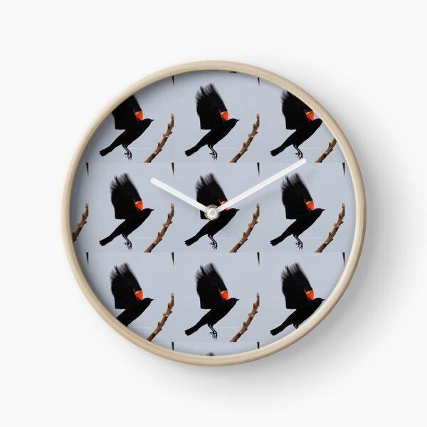 Fly high, dear Red winged blackbird By Yannis Lobaina Clock