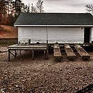 A Boathouse with open door by Jim Haley