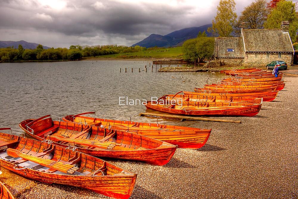 Wooden boats waiting at Keswick, Lake District, UK by Elana Bailey