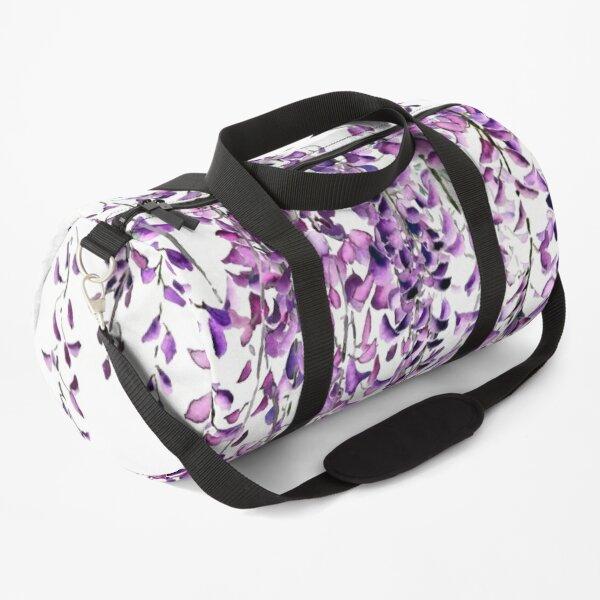 lila Glyzinien in voller Blüte Sporttasche