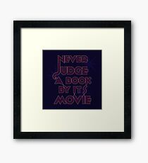 Never Judge A Book By Its Movie (Purple on Blue) Framed Print