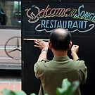 the sign writer - meticulous in his craft. by geof
