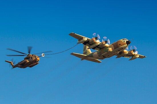 Hercules C-130 transport plane refuelling by PhotoStock-Isra