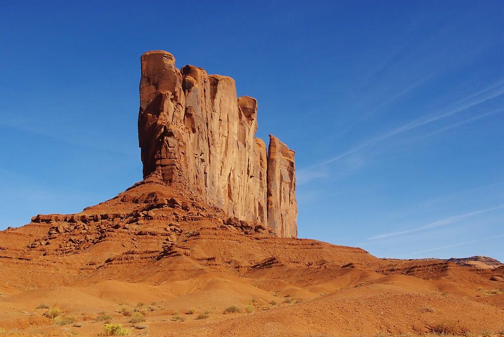 Spectacular rock wall, Monument Valley, Arizona by Claudio Del Luongo