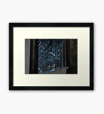 Stained glass window at night Framed Print