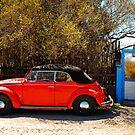 Red Convertible Volkswagen Beetle by Sam Scholes