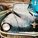 Old Chrysler Sedan in a Junk Yard by Sam Scholes