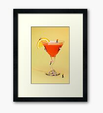Climbing on red wine cup Framed Print