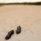 Shoes in sand by pahas