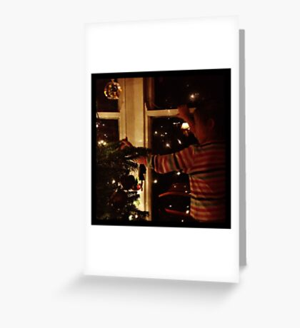 Putting decorations on the tree Greeting Card