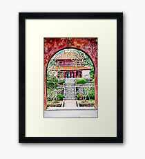 Temple through archway in Hue Framed Print