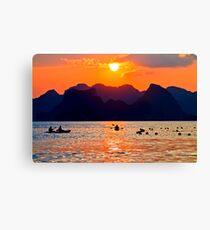 Halong Bay kayaks and sunset Canvas Print