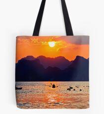 Halong Bay kayaks and sunset Tote Bag
