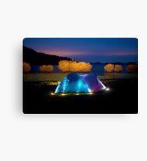 Illuminated tent on dam Canvas Print