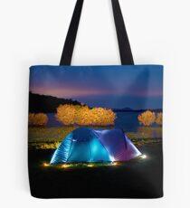 Illuminated tent on dam Tote Bag