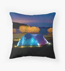 Illuminated tent on dam Throw Pillow
