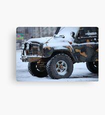 SUV in snow Canvas Print