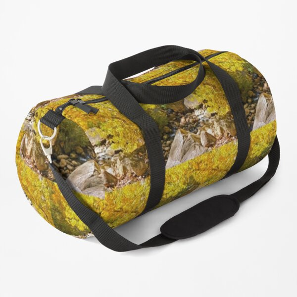 AUTUMN TREE LEANING OVER THE RIVER Duffle Bag