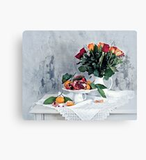Still life with red pomegranate, orange tangerines and roses Canvas Print
