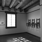 Chairs on the Wall by Tracy Riddell