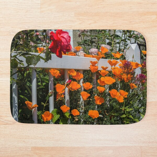 Orange and red flowers on a garden fence Bath Mat