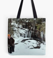 Winter Hiker At The Cliff's Edge Tote Bag