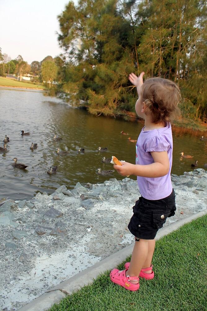 Ella Feeding the Ducks by Jenelle  Irvine