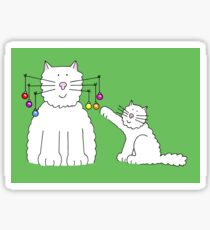 Cat with baubles on whiskers, and kitten playing with them. Sticker